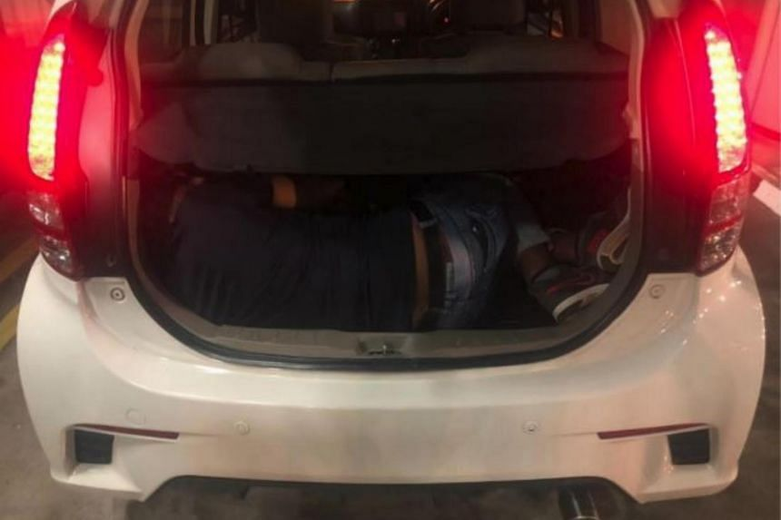 The 31-year-old Bangladeshi was found hiding in a car boot when ICA officers conducted checks at Woodlands Checkpoint on Aug 5.