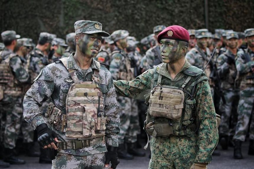 Lieutenant-Colonel Fabian Pwi (right), Commanding Officer, 1st Commando battalion, and Major Luo Changjian, Battalion Officer of the 74th Army Group, PLA Southern Theater Command Army, at the closing ceremony of Exercise Cooperation on Aug 5, 2019.