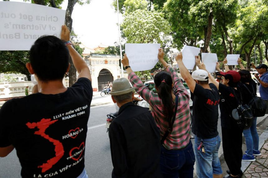 """Protests in the authoritarian and Communist-ruled South-east Asian country are rare, and police dispersed the short-lived demonstration of about 10 activists of the """"No-U"""" group within minutes."""
