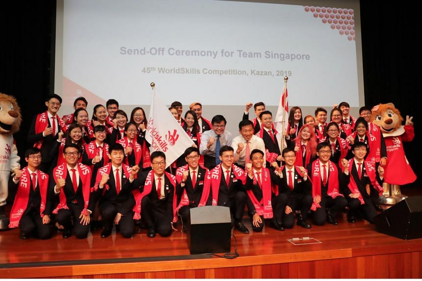 Education Minister Ong Ye Kung (centre, in white) and SkillsFuture Singapore CEO Ng Cher Pong with Singapore's teams for the WorldSkills Competition and Future Skills Competition, at the send-off ceremony at ITE Headquarters in Ang Mo Kio on Aug 6.