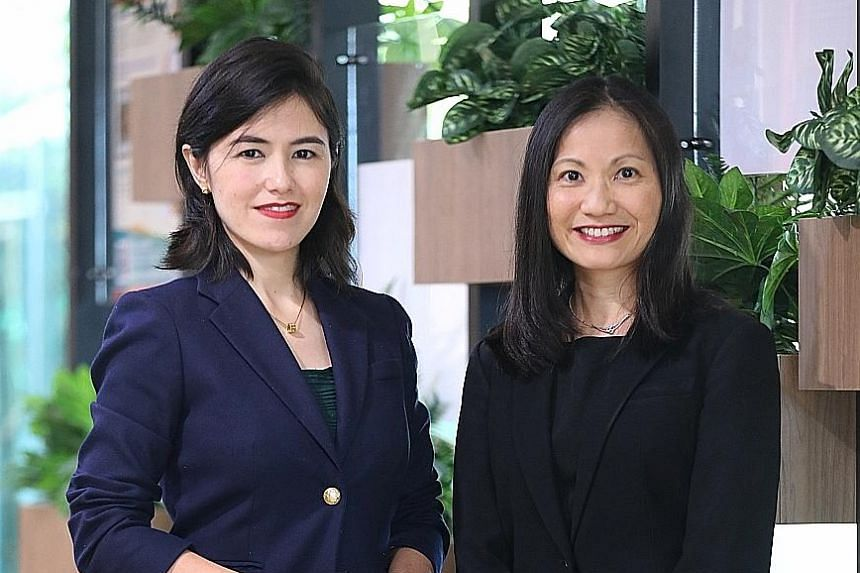 Mrs Natalie Morris-Sharma (far left), director of the Law Ministry's international legal division, and Ms Sharon Ong, the ministry's policy advisory director. Mrs Morris-Sharma chaired the United Nations' negotiations that led to the adoption of the