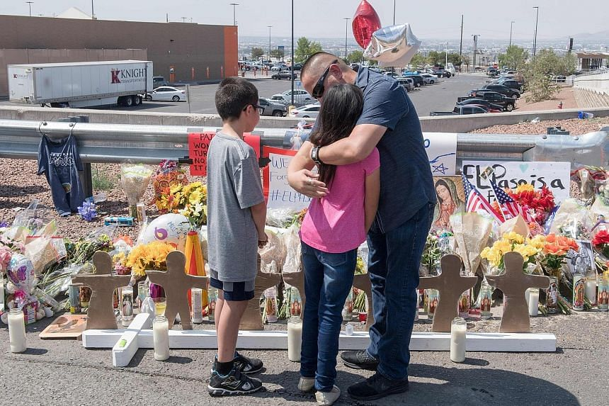 A family at a makeshift memorial for victims of the El Paso shooting. Domestic terrorism is an urgent issue at a time when white supremacists are causing more murders than Americans inspired by foreign groups.