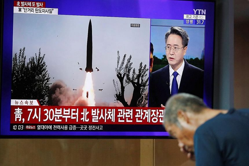South Korean television reporting yesterday on the North firing two unidentified projectiles from South Hwanghae province into the sea to the east.