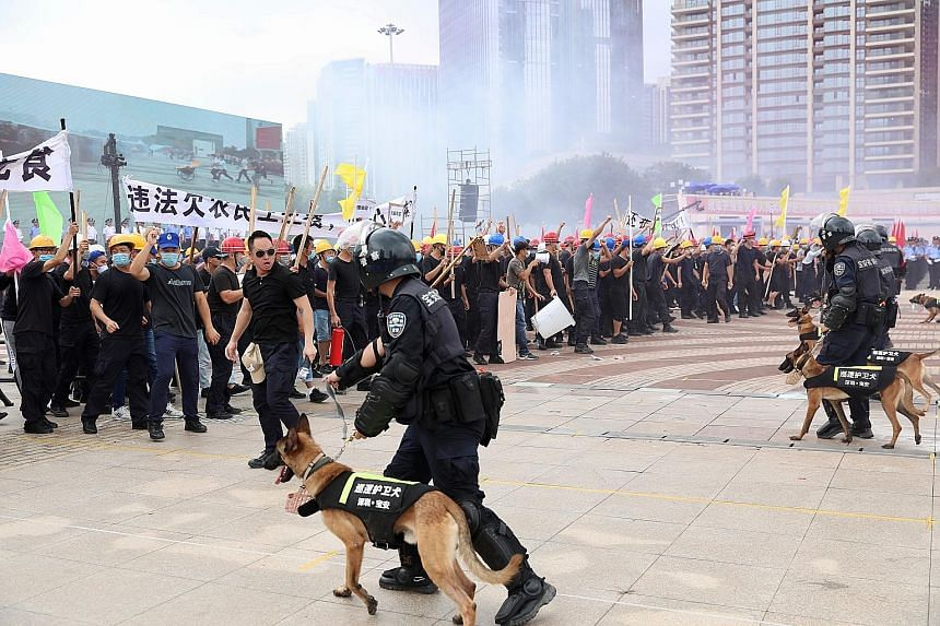 Police officers taking part in an anti-riot drill in Shenzhen in China's Guangdong province yesterday. Beijing has sent signals that a military option is on the table, releasing videos recently that show anti-riot personnel training to disperse prote