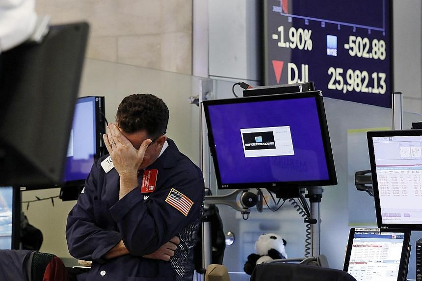 A trader at the New York Stock Exchange reacting on Monday as the Dow Jones plunged. The chances of a trade deal being reached before the US election next year look slim, said one analyst.