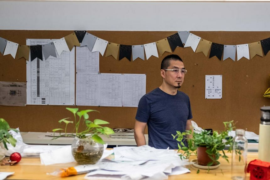 Zhang Zhiyang at his architecture firm in Shenzhen, China, Aug 1, 2019. Mr Zhang is now accepting the financial equivalent of IOUs from as many as one-third of his clients instead of cash.