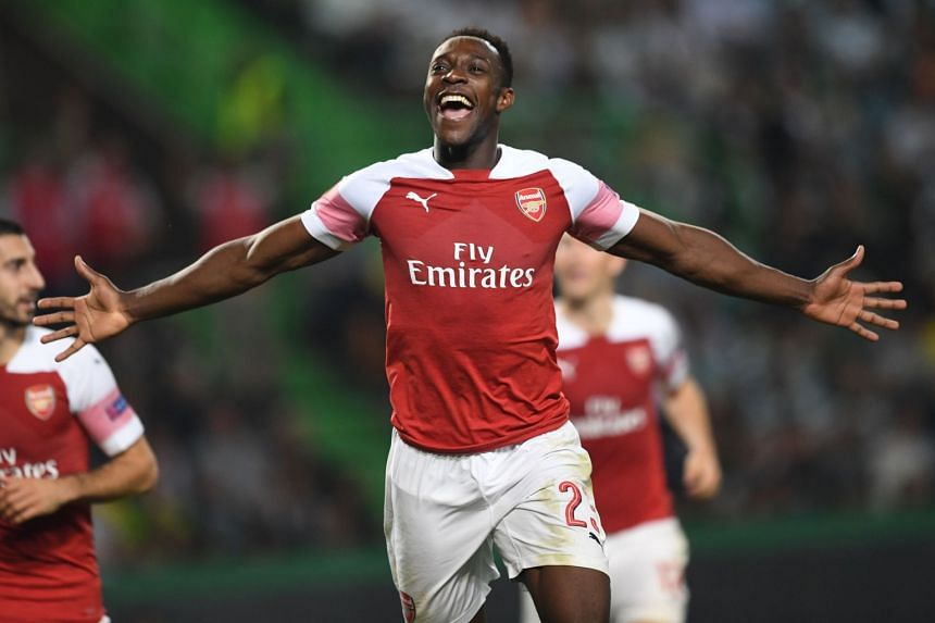 A 2018 photo shows Welbeck in action for Arsenal.