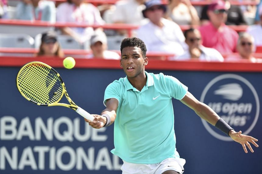 Canada's Felix Auger-Aliassime hits a return against Vasek Pospisil during day 5 of the Rogers Cup at IGA Stadium on Aug 6, 2019.