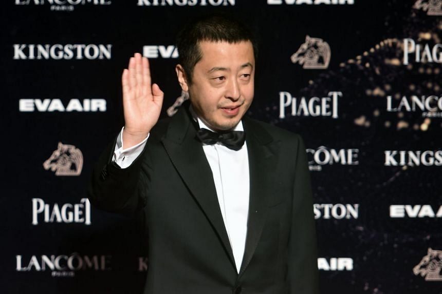 In a picture taken on Nov 21, 2015, Chinese film director Jia Zhangke arrives at the 52nd Golden Horse Film Awards in Taipei.