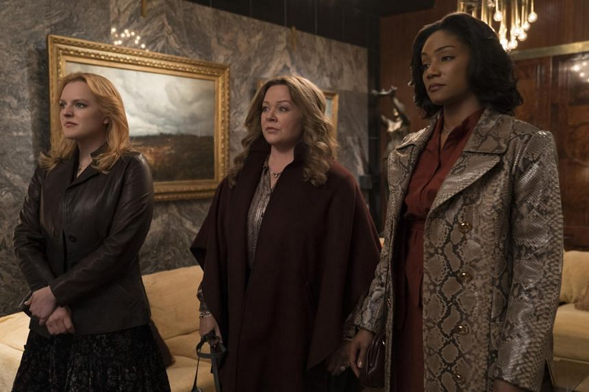 (From left) Elisabeth Moss, Melissa McCarthy and Tiffany Haddish in The Kitchen.