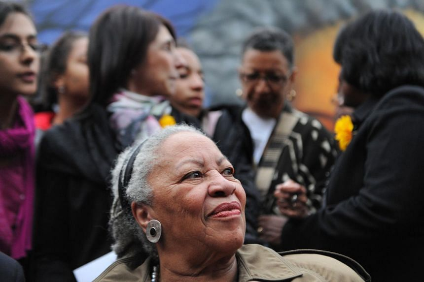 In this photo taken on Nov 5, 2010, Nobel-winning US novelist Toni Morrison (centre) attends the unveiling ceremony of a memorial bench marking the abolition of slavery in Paris.
