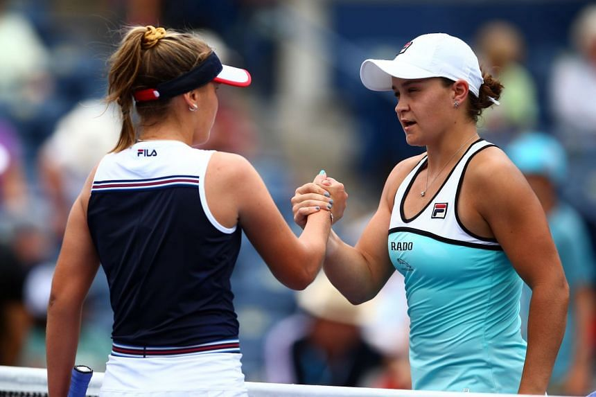 Kenin of the United States shakes hands with Barty after the match.
