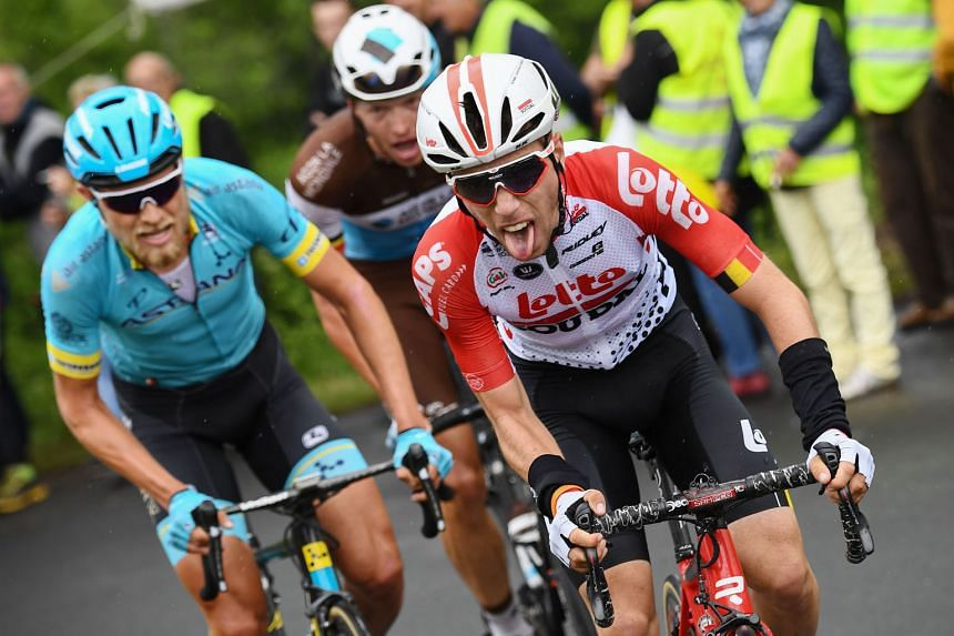 Lotto-Soudal rider Bjorg Lambrecht (right) leading a breakaway during the first stage of the Criterium du Dauphine in June. The Belgian cyclist died on Monday after colliding into a concrete structure during the Tour of Poland.