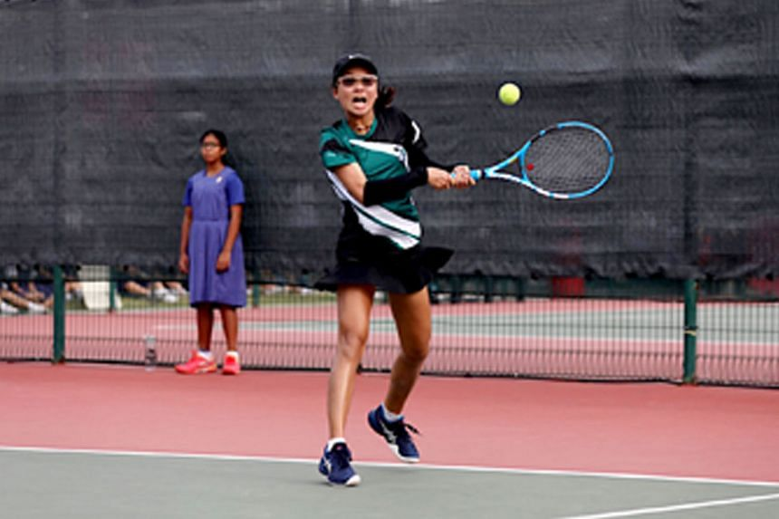 Charlotte Yeo hitting a return during the Schools National C Division final. Her straight sets win helped Raffles Girls' School to the title.