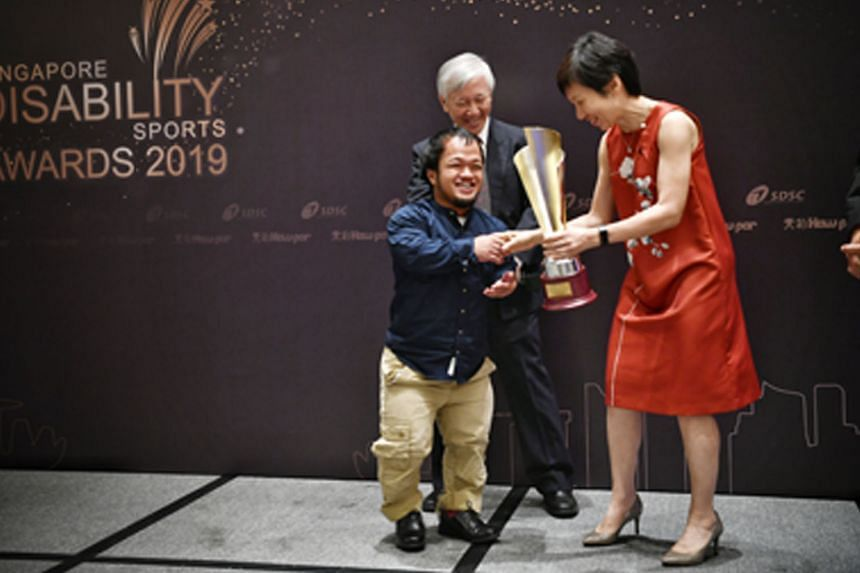 Above: Sportswoman of the Year Yip Pin Xiu holding her trophies at the awards ceremony last night. Left: A jubilant Muhammad Diroy Noordin receiving his Sportsman of the Year trophy from Culture, Community and Youth Minister Grace Fu.