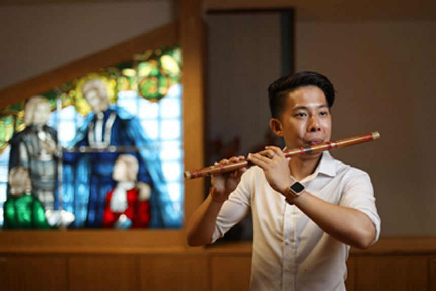 Suffering from partial hearing loss in both ears, Mr Ong Ting Kai, 29, hears only the bass line and drumbeats in a piece of music. That has not stopped him from passing on his musical passion, as a music teacher at St Gabriel's Secondary School. ST P