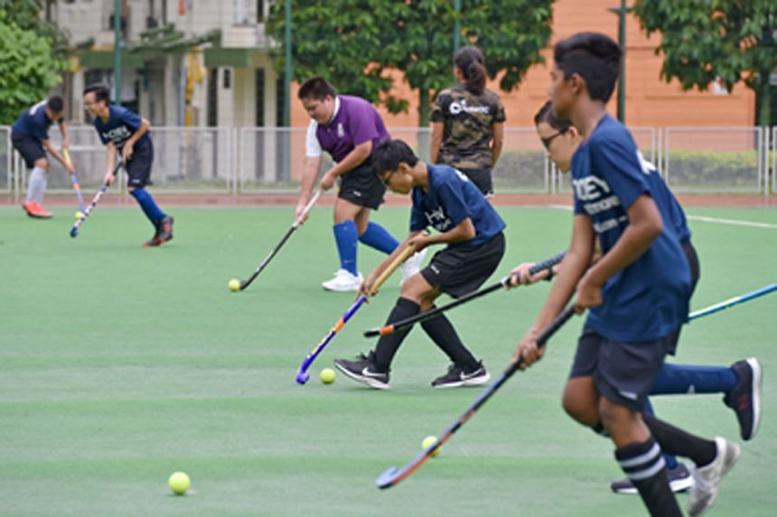 Boys from the combined team of ACS (Barker Road) and Queensway Secondary during their twice-a-week training sessions at the Delta Hockey Pitch. Each school now has 18 hockey players.