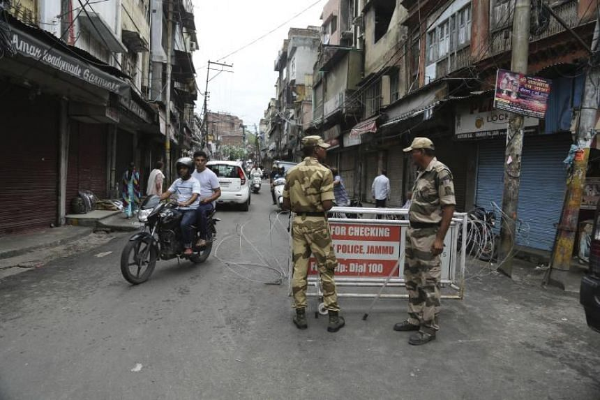 Security officers stand guard near a barricade in Jammu, India, Wednesday, on August 7, 2019.
