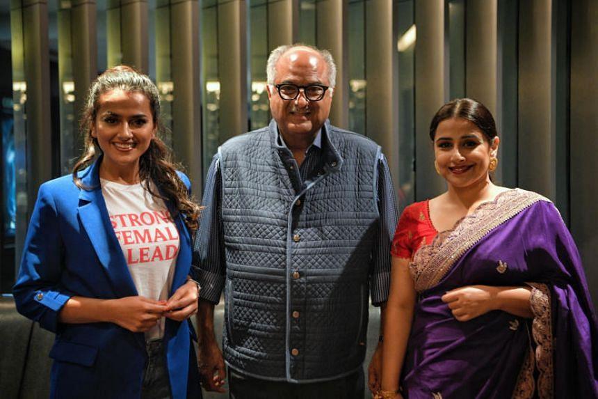 (From left) Shraddha Srinath, Boney Kapoor, and Vidya Balan at the premiere of Nerkonda Paarvai in Singapore.