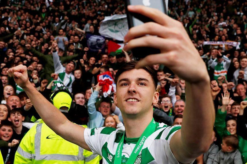 Celtic's Kieran Tierney takes a selfie as he celebrates winning the Scottish premiership.
