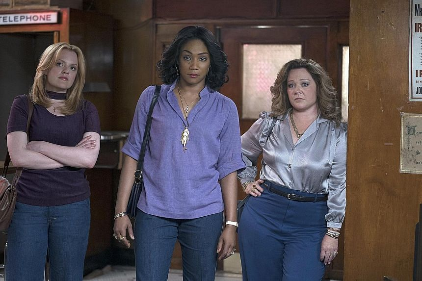 In The Kitchen, (from left) Elisabeth Moss, Tiffany Haddish and Melissa McCarthy play wives who come to enjoy having criminal lifestyles and being in charge.