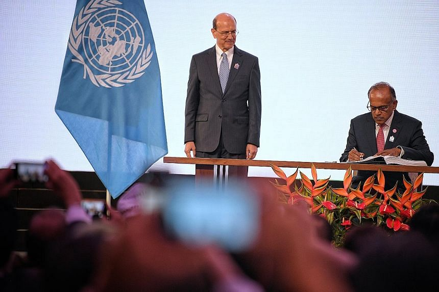 Law and Home Affairs Minister K. Shanmugam with UN Assistant Secretary-General for Legal Affairs Stephen Mathias during the Singapore Convention on Mediation signing ceremony yesterday.