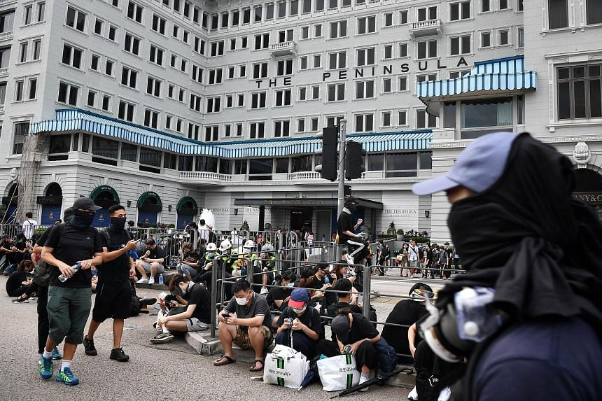 Protesters outside The Peninsula hotel in Hong Kong's Tsim Sha Tsui shopping district. Hongkong and Shanghai Hotels, the owner of the hotel, said it was worried about the impact of the protests on tourist arrivals and on the broader economy, while Ca