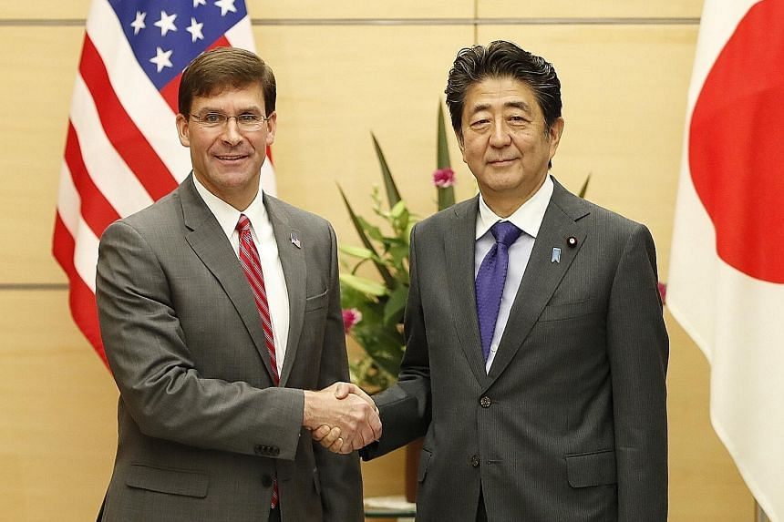 """US Secretary of Defence Mark Esper with Japanese Prime Minister Shinzo Abe in Tokyo yesterday. Mr Abe said the Japan-US security alliance has """"never been stronger"""", a sentiment that Dr Esper echoed, calling it ironclad and crucial to a free and open"""