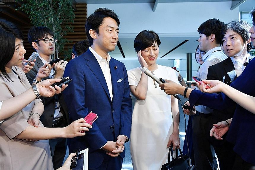 Mr Shinjiro Koizumi and Ms Christel Takigawa at their wedding announcement in Tokyo yesterday. Mr Koizumi is the son of Japan's former leader Junichiro Koizumi, while Ms Takigawa is a French-Japanese TV personality known as the face of Tokyo's succes