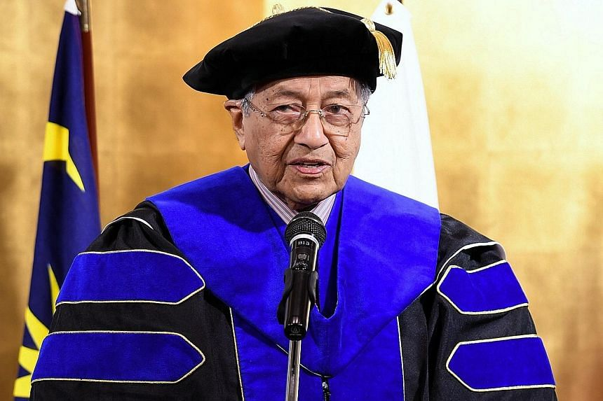Malaysian Prime Minister Mahathir Mohamad delivering his acceptance speech in Fukuoka, Japan, yesterday after being conferred an honorary doctorate by the International University of Japan in recognition of his contributions to bilateral relations. H