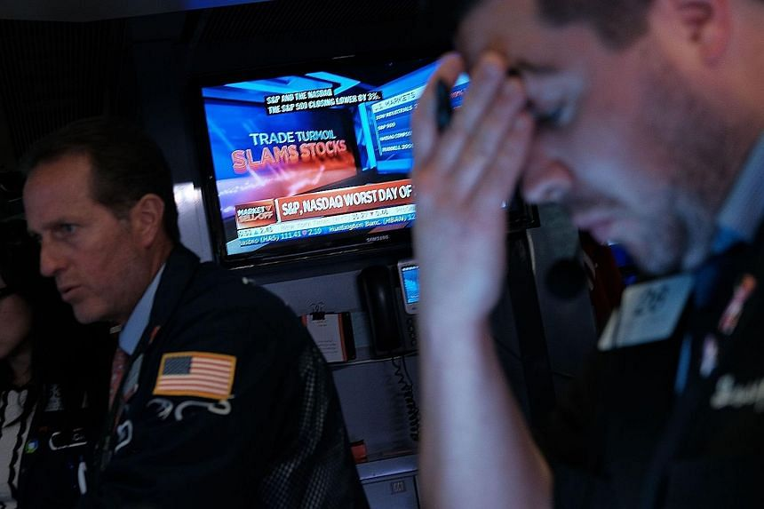 A trader on the floor of the New York Stock Exchange on Monday, when all three major US stock indexes nose-dived.