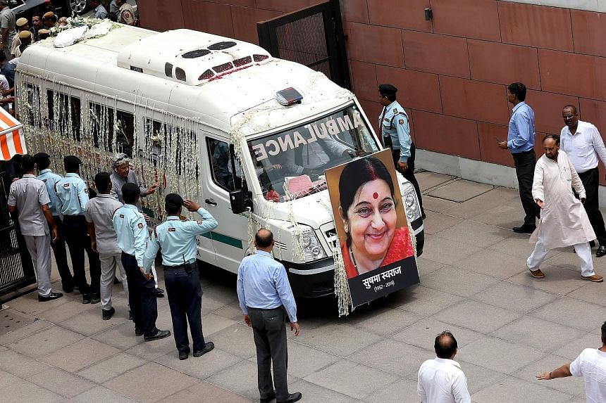 A vehicle carrying the body of former Indian external affairs minister Sushma Swaraj arriving at the headquarters of the ruling Bharatiya Janata Party in New Delhi yesterday.