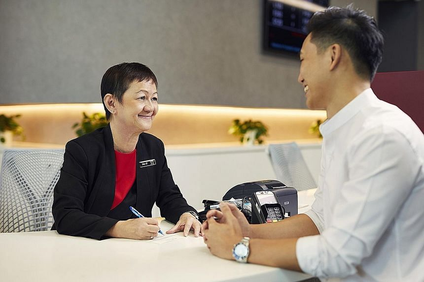 Customer service officer Sue Li, 63, is among Prudential's staff who will benefit from the new scheme. The firm said the scheme is opt-in as some may prefer more disposable income to meet their immediate needs.