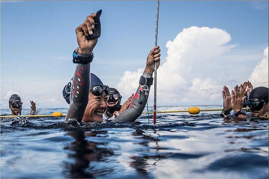 Freediver Lim Anqi (above) competing in the recent Caribbean Cup in Honduras (right). She came third in the constant weight no fins discipline, diving to a depth of 47m and breaking her previous 45m record.