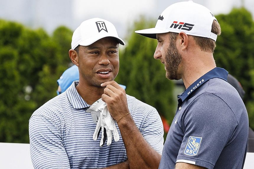 Former world No. 1 Tiger Woods (left) during a practice round before this week's Northern Trust Open at the Liberty National Golf Club. He finished joint-second at the same course in the Barclays event in 2009 and 2013. PHOTO: EPA-EFE