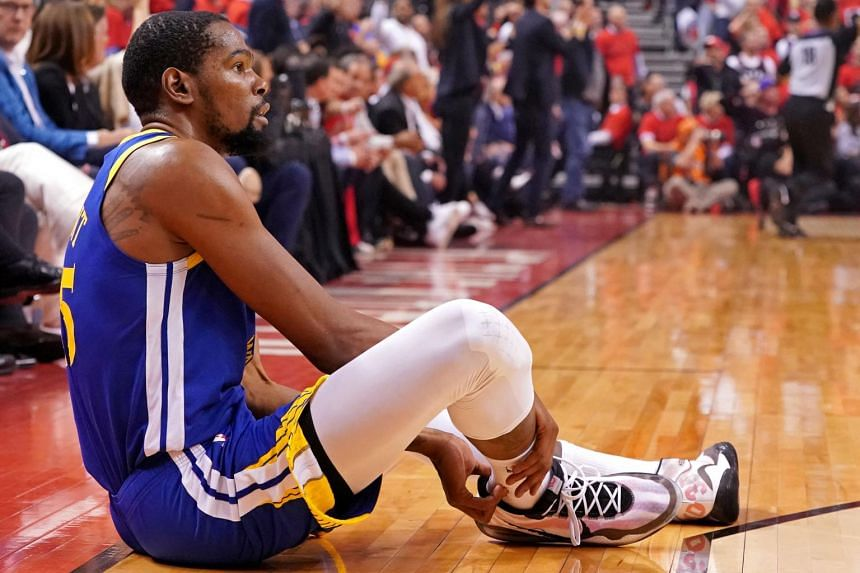 In a picture taken Jun 10, 2019, Golden State Warriors forward Kevin Durant sits on the court after an apparent injury during the second quarter in game five against the Toronto Raptors of the 2019 NBA Finals at Scotiabank Arena.