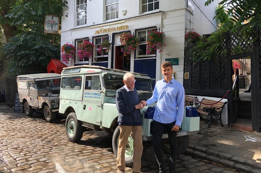 Mr Tim Slessor and his grandson Nathan George stand outside the Grenadier pub before Mr George sets off on an overland trip from London to Singapore.