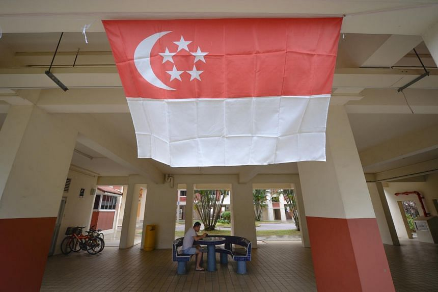 A file photo of the Singapore flag at a HDB block void deck in Bishan taken on July 8, 2019.