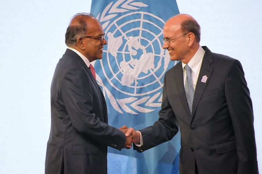 Law and Home Affairs Minister K Shanmugam shakes the hand of UN Assistant Secretary-General for Legal Affairs Stephen Mathias before the signing ceremony on Aug 7, 2019.