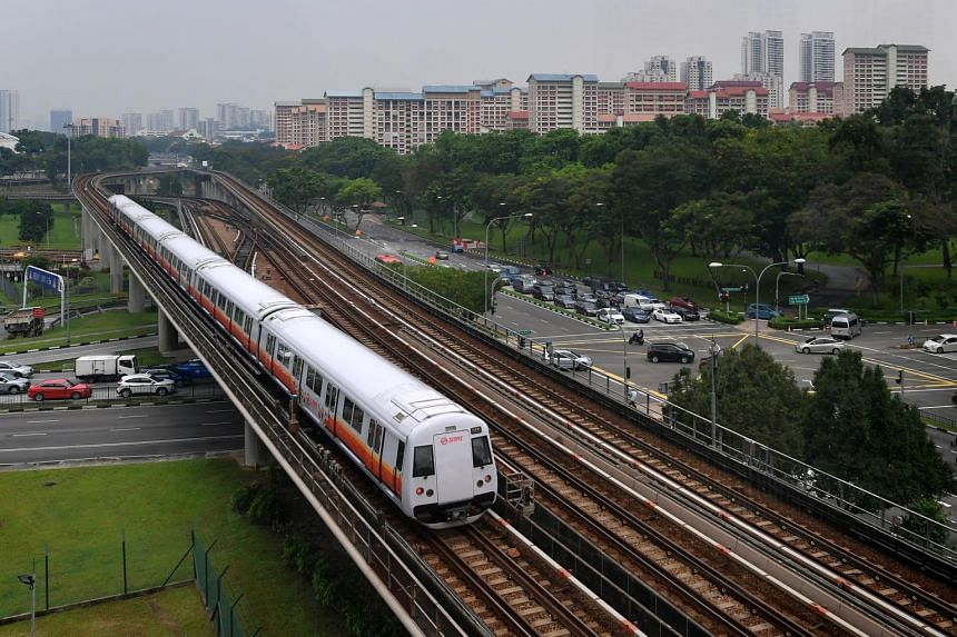 A MRT train passes by Ang Mo Kio Avenue 8.