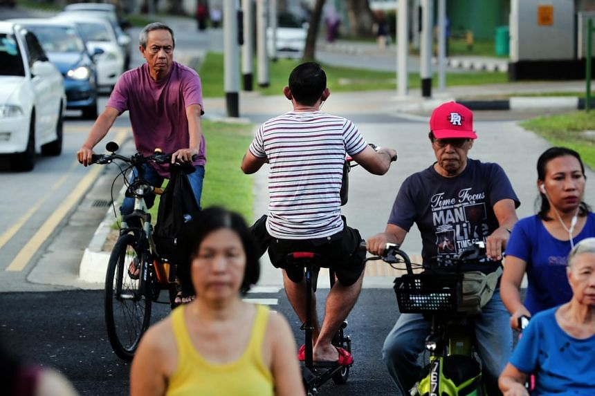 A man riding a PMD against traffic at the Bugis area.