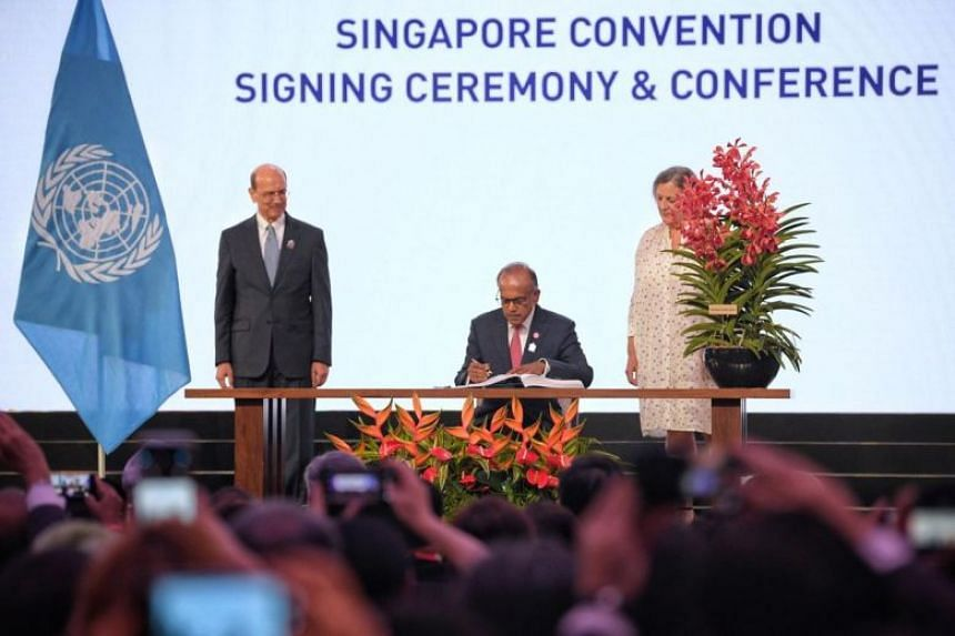Home Affairs and Law Minister K. Shanmugam signing the Singapore Convention on Aug 7, 2019.