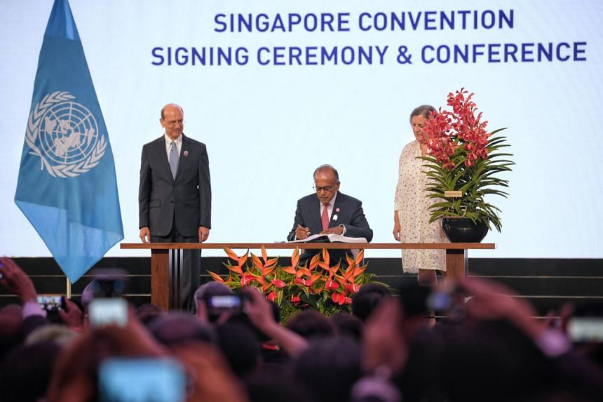 Law and Home Affairs Minister K Shanmugam (seated) at the the signing ceremony of the Singapore Convention on Mediation on Aug 7, 2019.