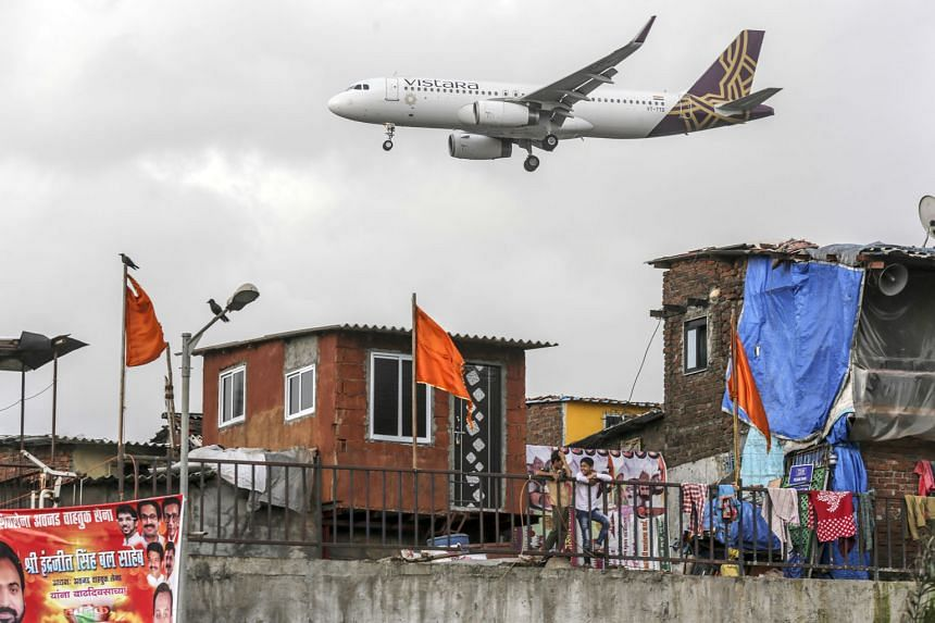 A Vistara aircraft preparing to land in Mumbai in a 2017 file photo. Vistara, which is 49 per cent owned by Singapore Airlines and 51 per cent by Tata Group, launched its first overseas service between New Delhi and Singapore on Tuesday. The carrier