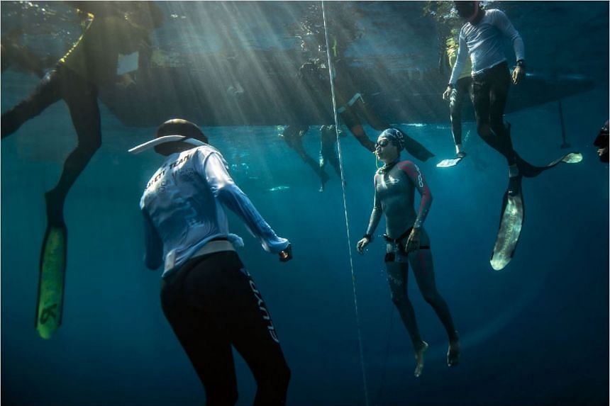 Freediver Lim Anqi competing in the recent Caribbean Cup in Honduras (above). She came third in the constant weight no fins discipline, diving to a depth of 47m and breaking her previous 45m record.