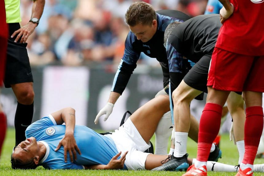 Manchester City's Leroy Sane reacts after sustaining an injury on Aug 4, 2019.