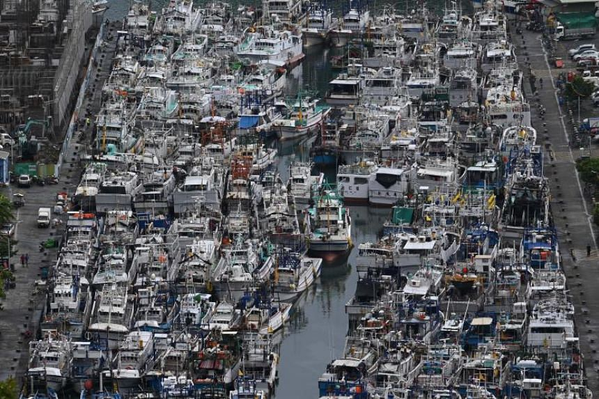 Fishing boats packed into the typhoon shelter at Nanfangao harbour in Suao, Yilan county, as Typhoon Lekima approaches off the shores of eastern Taiwan on Aug 8, 2019.
