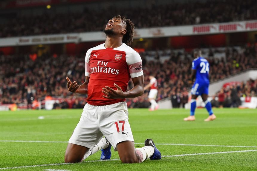 Iwobi reacts during am Arsenal match against Leicester City.