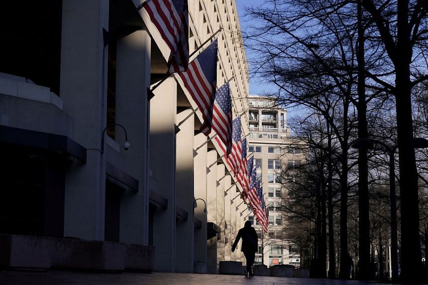 A pedestrian walks past the headquarters of the Federal Bureau of Investigation in Washington.