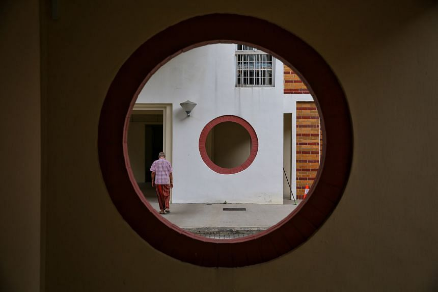 Porthole openings in the walls along common areas at Blocks 152 to 161 in Pasir Ris Street 13.